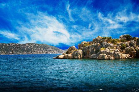 Beautiful peninsula,  turquoise sea and blue sky. photo