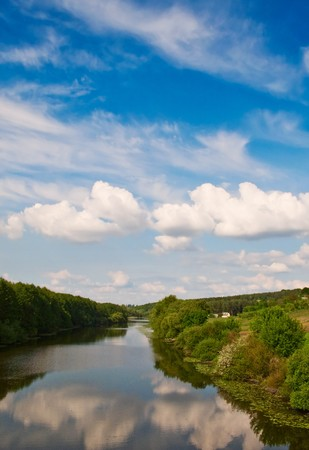 Small river and clouds in the blue sky. photo