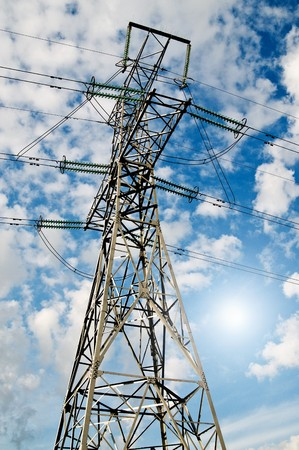 Electrical pylon on a background of the blue sky.