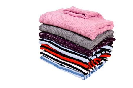 Warm,modern sweaters isolated on a white background. Stock Photo
