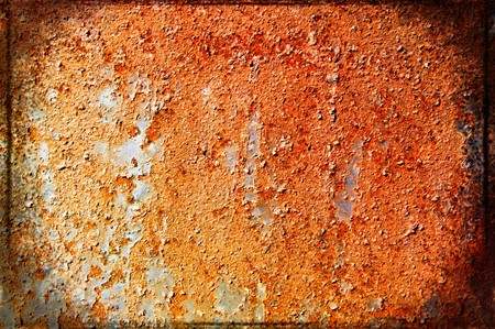 oxidized: Oxidized metal sheet covered with old paint  Stock Photo