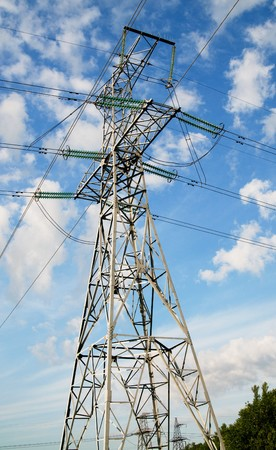 Electrical pylon on a background of the blue sky.  photo