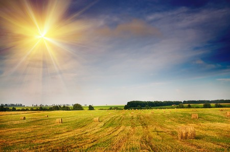 Beautiful stubble field with hay bales by summer. Stock Photo - 7556315