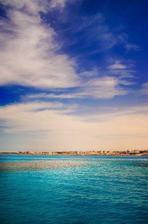 View of sea and construction  in the Sekalla area of Hurghada, Egypt photo