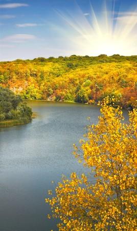 Wonderful autumn sunset  above of river photo