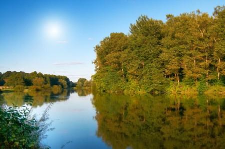 Wonderful panorama of autumnal lake. photo