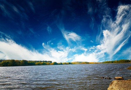 Wonderful autumn lake and blue sky with white clouds.    photo
