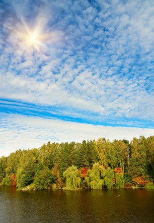 Autumnal landscape of lake and blue sky. Stock Photo - 8089306
