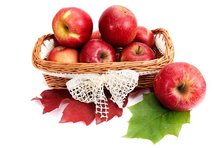 Amazing  basket full of autumn fruits isolated on a white background. photo