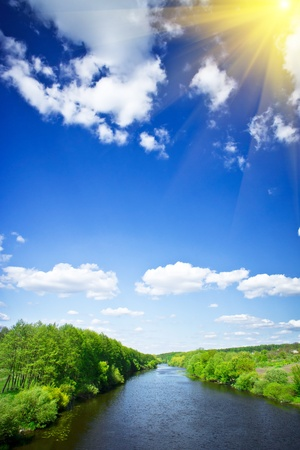 Small river and sun in the blue sky. photo