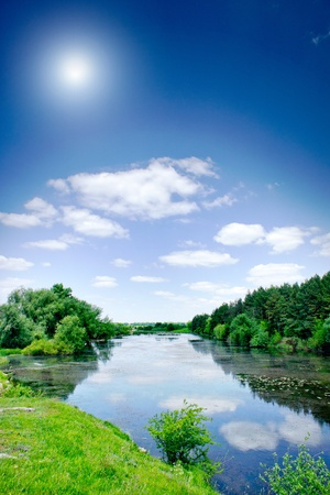 Small river , sun and blue sky. photo