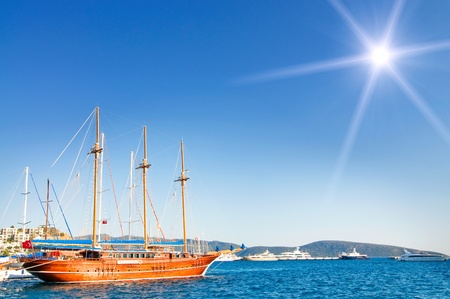 Wonderful yacht in blue bay near Bodrum town.  Turkey.  photo