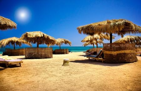 sunbeds: Wooden sunbeds  on the beach