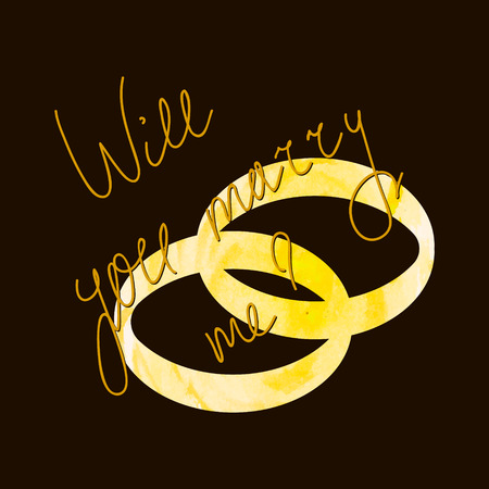 Will you marry me question on the gold wedding rings background.