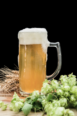 beer with hop and wheat and a glass