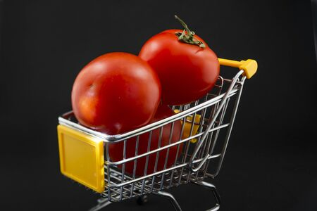 small cart with tomatoes