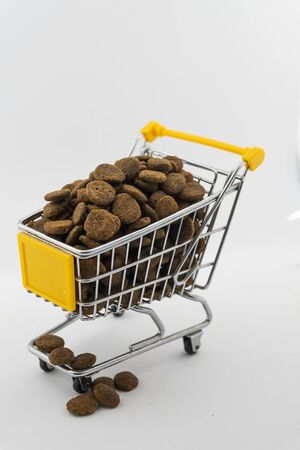 cart with dog food on a white background