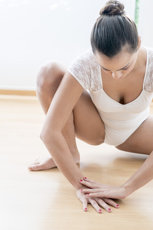 Beautiful girl doing  ballet and yoga in a white scenary Stock Photo