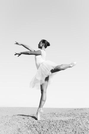 Beautiful young ballerina posing outdoor in nature