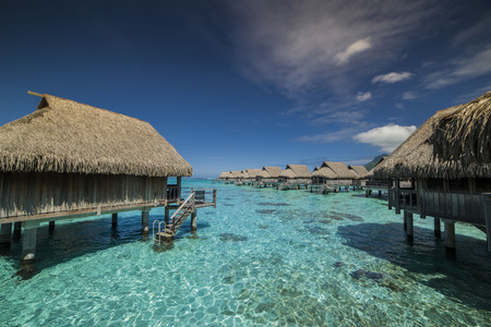 Overwater Bungalows in sunny day, French Polynesia