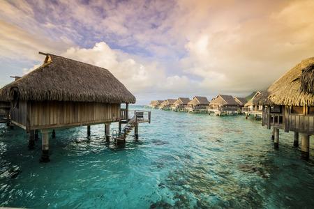 polynesia: Overwater Bungalows at early morning, French Polynesia Stock Photo
