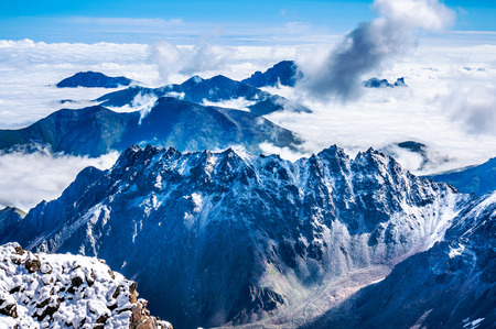 caucas: The Caucas mountains over the clouds, Bezengi region, Russia Stock Photo