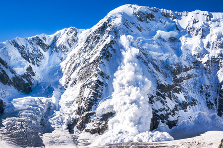 shkhara: A real avalanche in the Caucasus, from Shkhara mountain Stock Photo