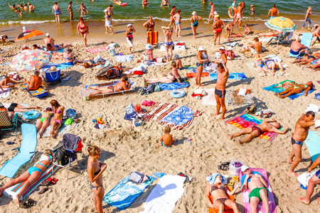 a lot of people sunbathing on the beach in the south in the summer Editorial