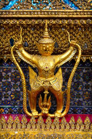 in wat phra kaew: sculpture of Garuda and Naga in the Wat  Phra Kaew temple, Bangkok, Thailand Stock Photo