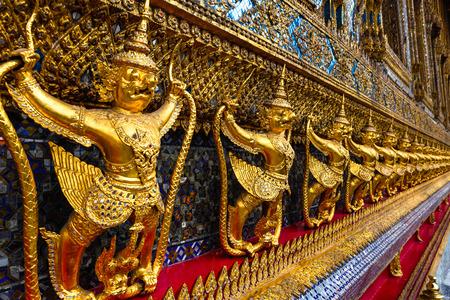 in wat phra kaew: sculptures of Garuda and Naga in the Wat  Phra Kaew temple, Bangkok, Thailand