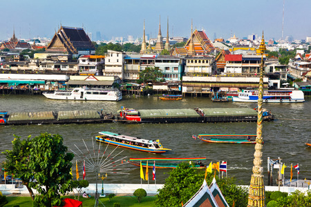 south asian ethnicity: View from Wat Arun on the Chao Phraya River and the temple of Wat Pho in Bangkok, Thailand
