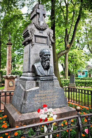 novelist: Sculptural monument on the grave of  Fyodor Dostoyevsky, a famous Russian novelist, short story writer, essayist, journalist and philosopher. Necropolis, Alexander Nevsky Lavra, St. Petersburg, Russia