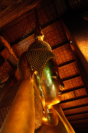 Face of the Reclining Buddha in Wat Pho temple, Bangkok, Thailand