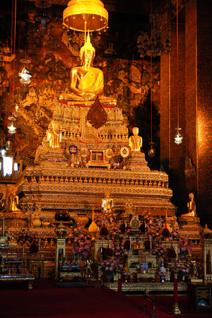 Sitting Buddha Gold Statue in Buddhist Temple. Wat Pho, Bangkok, Thailand