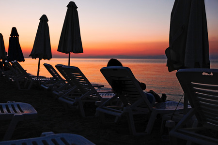 Evening view of the sea with sun loungers