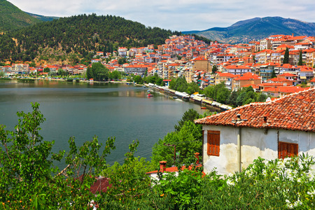 view of the city by the lake Orestiada. Kastoria, Greece Imagens