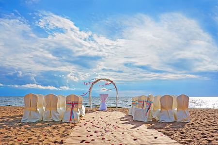 Wedding ceremony place in modern european style with the arch on the beach with nobody Imagens