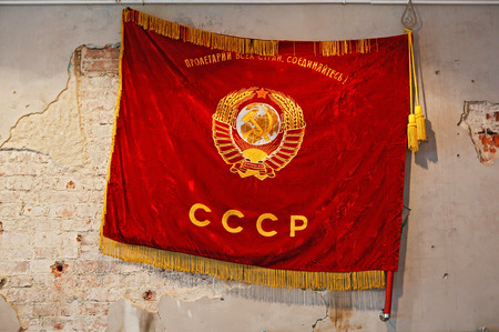 Flag of Soviet Union hanging on the shabby wall
