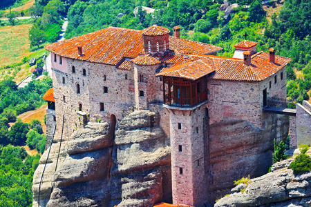 View of the Holy Monastery of Rousanou-St. Barbara. It was founded in the middle of 16th century and decorated in 1560. Meteora, Greece