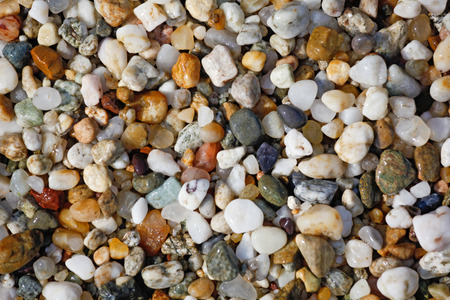 background or wallpaper from small sea pebbles Imagens