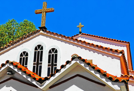 Hanioti, Greece - July 04, 2012: part of the facade of the  orthodox greek church
