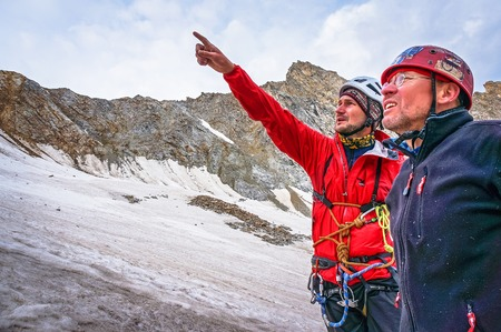 rise to the top: CAUCASUS, KABARDINO-BALKARIA, RUSSIA - JULY 23, 2014:  Climbers discuss tactics rise to the top Editorial