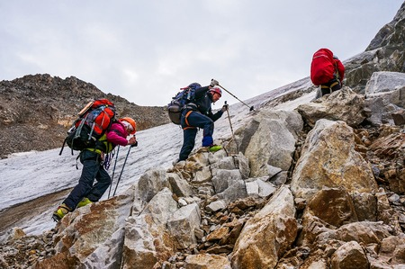 CAUCASUS, KABARDINO-BALKARIA, RUSSIA - JULY 25, 2014:  Group of climbers ascent to the mountain during a sporting hike