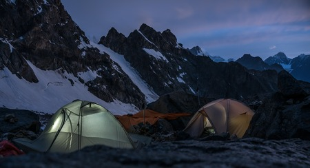Mountaineers bivouac at night in very high snowy mountains.