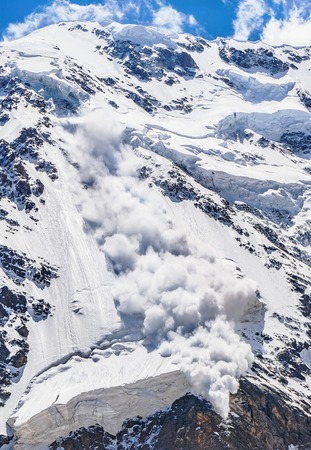 Power of nature. Real powerful avalanche comes from a big mountain, Caucasus, Kabardino-Balkaria, Bezengi region, Russia