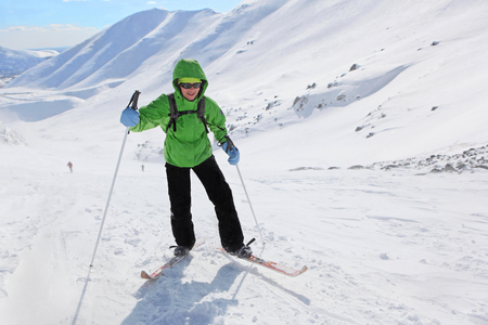 Murmansk region,Russia - April 11, 2013: a young woman rises in the snowy slopes on skis in Hibiny mountains.