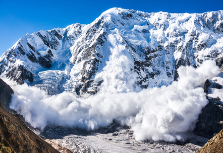 Power of nature. Real huge avalanche comes from a big mountain (Shkhara, 5,193 m), Caucasus, Kabardino-Balkaria, Bezengi region, Russia