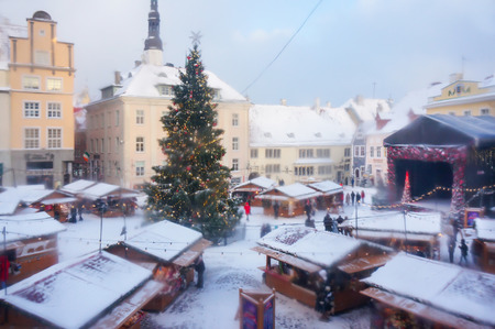 Tallinn, Estonia - January 05, 2017: traditional christmas market in the historic center of the town. Soft shot through an old window