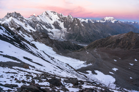 vertices: Sunset in high snowy mountains. The view from the pass, a birds-eye view