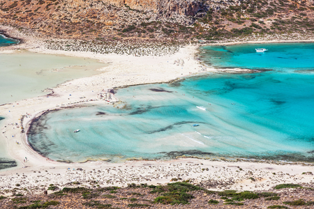 Wonderful sea lagoon with clear turquoise water on a bright sunny day looks like a paradise. Balos bay on Crete island, Greece.
